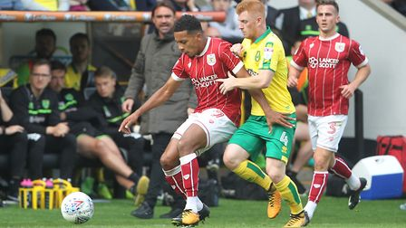 Korey Smith holds off Harrison Reed as Daniel Farke watches on at Carrow Road. Picture: Paul Chester