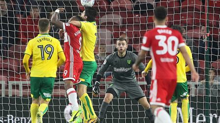 Timm Klose of Norwich gets a grip of Britt Assombalonga of Middlesbrough in the area during the Sky