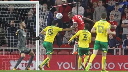 Middlesbrough striker Britt Assombalonga heads for goal but his effort was cleared off the line by