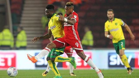 Alexander Tettey of Norwich and Britt Assombalonga of Middlesbrough in action during the Sky Bet Cha