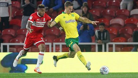 Britt Assombalonga of Middlesbrough and Christoph Zimmermann of Norwich in action during the Sky Bet
