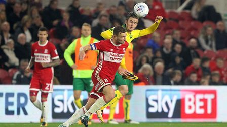 Ben Gibson of Middlesbrough and James Maddison of Norwich in action during the Sky Bet Championship