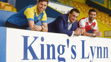Grant Holt and Simon Lappin pose with King's Lynn Town chairman Stephen Cleeve after signing for the