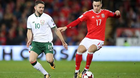 Robbie Brady, left, in action against Wales. Picture: PA