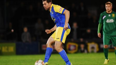 Grant Holt on the ball for King's Lynn after coming on as a second half substitute. Picture: Ian Bur