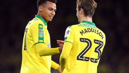 Josh Murphy celebrates scoring Norwich City's opening goal at Arsenal with the man who made it, Jame