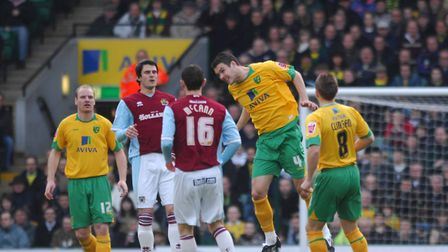 Jason Shackell getting his head on the ball during a game against Burnley at Carrow Road. Picture: A