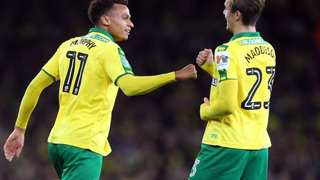 Josh Murphy, left, celebrates his goal for Norwich City at Arsenal with James Maddison. Picture by P