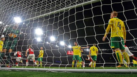 Norwich players look dejected after conceding the second goal at the Emirates Stadium. Picture: Paul