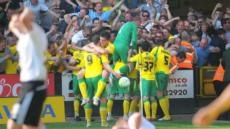 Norwich City celebrate Simeon Jackson's injury time winner against Derby County. Picture: Paul Chest