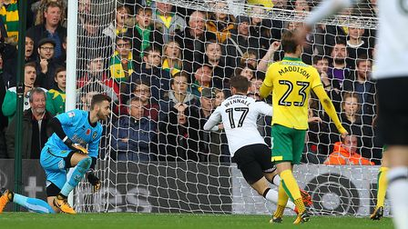 Sam Winnall slots Derby County's late winner at Carrow Road. Picture: Paul Chesterton/Focus Images L