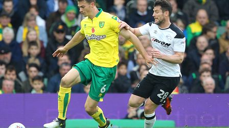 Derby County striker David Nugent harries Christoph Zimmermann as Norwich City succumbed at Carrow R