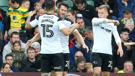 David Nugent celebrates opening the scoring for Derby County at Carrow Road with former Norwich City