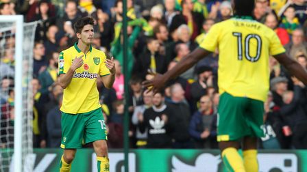 Timm Klose (left) and Cameron Jerome try to get the Norwich City crowd going following the defender'