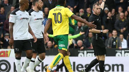 Referee Peter Bankes awards only a corner after Norwich City winger Josh Murphy is brought down by D