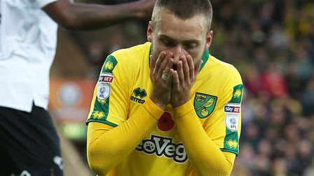 Tom Trybull is left with his head in his hands after missing a big chance for Norwich City - moments
