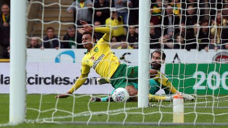 Josh Murphy goes down under Scott Carson's challenge inside the Derby County penalty area. Picture: