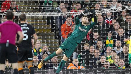 Angus Gunn denies Ruben Neves in the first half at Carrow Road. Picture: Paul Chesterton/Focus Image