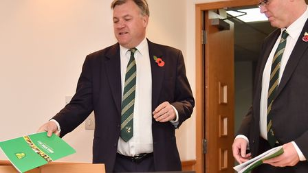 Norwich City chairman Ed Balls, left, and managing director Steve Stone present the NCFC annual acco