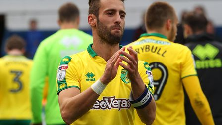 Ivo Pinto celebrates Norwich City's victory at Ipswich Town - one of several wins under his captainc