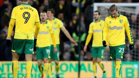 The Norwich players look dejected after conceding their sides first goal during the Sky Bet Champion