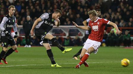 Marley Watkins of Norwich has a shot on goal during the Sky Bet Championship match at the City Groun