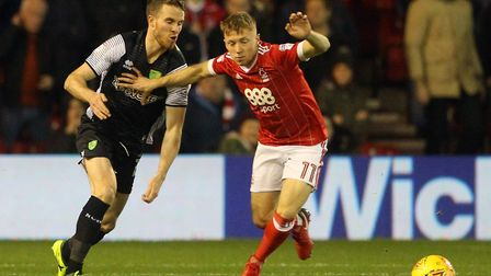 Marley Watkins of Norwich and Ben Osborn of Nottingham Forest in action during the Sky Bet Champions