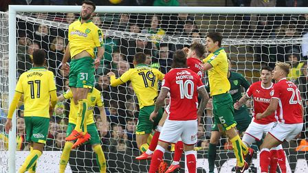 Grant Hanley rises highest to head clear for Norwich City during their 1-1 EFL Championship draw wit