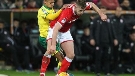 Barnsley defender Liam Lindsay and Norwich City forward Josh Murphy fight for possession at Carrow R