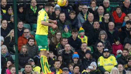 Grant Hanley heads clear during Norwich City's 1-1 draw with Barnsley - only his second start for th