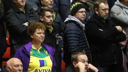 No words needed as the expressions of the traveling Norwich fans says it all as they watch their tea