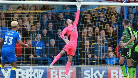goalkeeper Remi Matthews tips over the bar late in the second half during the Sky Bet League 1 match