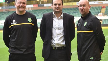 Norwich City sporting director Stuart Webber, centre, has rung the changes at Colney alongside acade