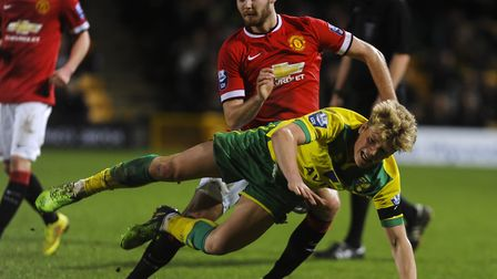 Cameron McGeehan is selt to the floor while on Norwich City development squad duty against Mancheste