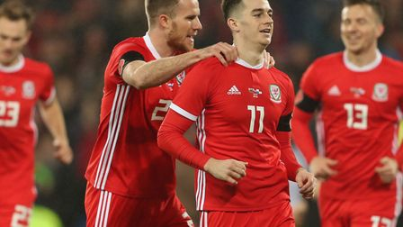 Marley Watkins congratulates Tom Lawrence after the opening goal against Panama at the Cardiff City