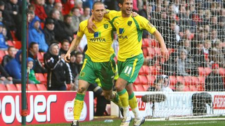 Andrew Crofts, left, celebrates with Andrew Surman after scoring against Barnsley at Oakwell in Febr