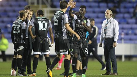 Timm Klose and Alex Tettey celebrate victory at Reading - but Tettey has not played since. Picture: