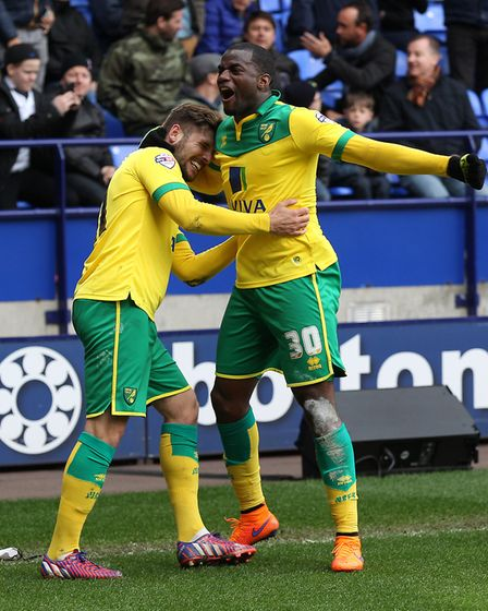 Gary Hoooper gets a hug from Sebastien Bassong after his winner at Bolton. Picture: Paul Chesterton/