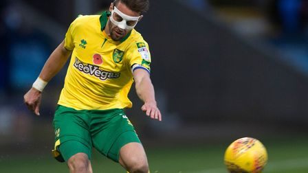Ivo Pinto sported a protective mask over a broken nose, as Norwich City lost at Bolton Wanderers. Pi