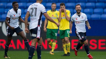 Adam Armstrong celebrates scoring Bolton Wanderers's second goal - and the Norwich City faces in the