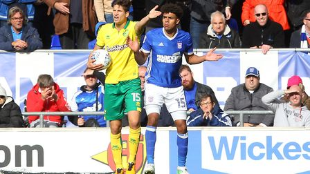 Timm Klose in control, Tom Adeyemi bemused. Picture: Paul Chesterton/Focus Images Ltd
