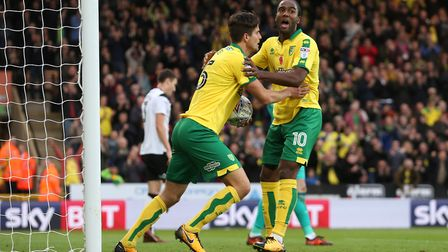 Timm Klose encourages his team-mates to get play going again after his equaliser against Derby but w