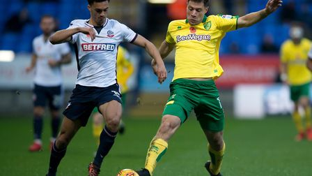 Yanic Wildschut stretches for the ball during Norwich City's Sky Bet Championship defeat at Bolton W