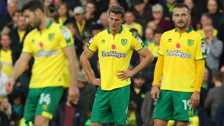 Norwich City's players - especially Christoph Zimmermann (centre) - cut dejected figures following t