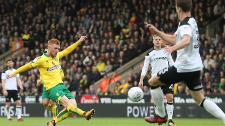 Harrison Reed of Norwich has a shot on goal during the Sky Bet Championship defeat to Derby at Carro