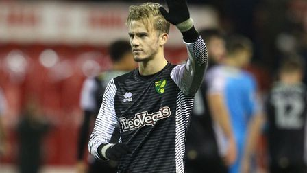 James Maddison of Norwich apologies to the travelling support at the end of the Sky Bet Championship