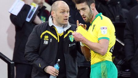 Ivo Pinto takes instructions from Alex Neil last season, during his time in charge of Norwich City.