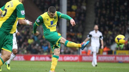 Gary Hooper pings home a glorious shot from range at home to Swansea, during Norwich City's 2013-14