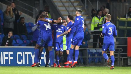 City's misery is complete at Cardiff on Friday night as Omar Bogle celebrates making it 3-1. Picture