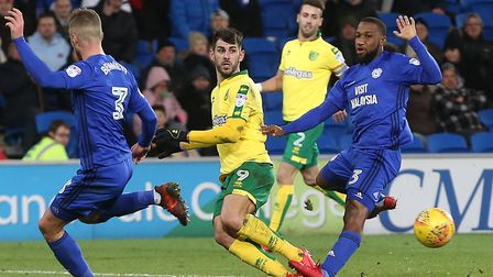 Nelson Oliveira crosses the ball, meaning this must be a picture from the second half of Norwich Cit